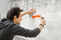 Graffiti artist about to start spraying a wall Stock Photography