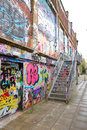 Graffiti brick wall art scale alley in germany Royalty Free Stock Images