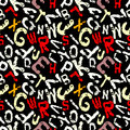 Graffiti colored letters on a black background grunge texture seamless background