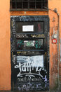 Graffiti doors in rome art on street Stock Photo