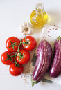 Graffiti eggplants,  tomatoes, garlic and olive oil Royalty Free Stock Photo