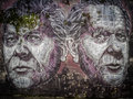 Graffiti faces portrait on the wall of a home in ponta delgada azores portugal Royalty Free Stock Images