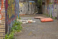 Graffiti and mattresses dumped walls neglected passage Stock Image