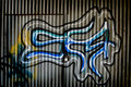 Graffiti on Metal Wall Royalty Free Stock Image