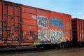 Graffiti on a red railroad car Royalty Free Stock Photo