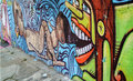 Graffiti of unidentified artist on the wall of the Batman Alley