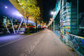 Graffiti on a wall and modern building along the danube canal at night in vienna austria Royalty Free Stock Image