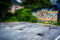 Graffiti on a wall and a parking lot in Little Five Points, Atla Royalty Free Stock Photo