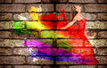 Graffiti of a woman in colorful dress on brick wall Royalty Free Stock Images