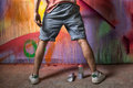 Grafitti artist in action lower body shot Royalty Free Stock Photography