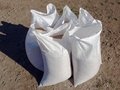 Grain bags white with new harvest outdoor on ground Stock Photos