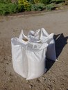 Grain bags white with new harvest outdoor on ground Royalty Free Stock Image