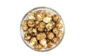 Grain brown popcorn in a glass cup Royalty Free Stock Photo