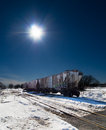 Grain Car on tracks with sun background. Stock Image