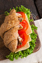 Grain croissant sandwich on a whiteboard and a dark background Royalty Free Stock Photo