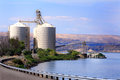 Grain elevator on river a large busy modern with a barge sitting ready to fill in eastern oregon columbia Stock Image