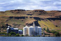 Grain elevators two large busy modern in eastern oregon on columbia river Stock Photo