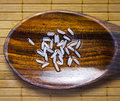 Grain rice wet wooden spoon Stock Photos