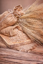 Grain in sacks and ears of wheat Royalty Free Stock Photo