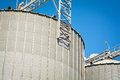 Grain silo detail of containers under the blue sky Stock Images