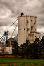 Grain silo working in dickenson nd Royalty Free Stock Image