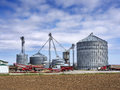 Grain silos on the farm agricultural elevator building for corn storage in Royalty Free Stock Photography