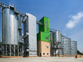 Grain silos huge placed in fertile plain Stock Photos