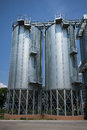 Grain silos huge placed in fertile plain Royalty Free Stock Photos