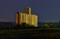 Grain silos by night for storing the cereals and crop Stock Photo