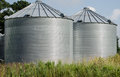Grain storage bins duo of on farm Stock Images
