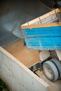 Grain truck harvested wheat pouring from into elevator Royalty Free Stock Photo