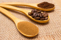 Grains, ground and instant coffee with wooden spoon on jute canvas Royalty Free Stock Photo