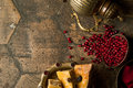 Grains of pomegranate on old paving stones Royalty Free Stock Photo