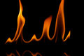 Grainy fire flames isolated on black background Stock Image