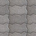 Grainy paving slabs seamless tileable texture gray wavy Royalty Free Stock Image