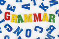 Grammar series education school subjects word made from colorful wooden letters Stock Image