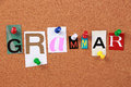 Grammar single word the in cut out magazine letters pinned to a corkboard Royalty Free Stock Photography
