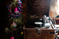Gramophone playing a record. with vinyl on background decorations, cap, tree and bright lights Royalty Free Stock Photo