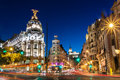Gran via in madrid spain europe rays of traffic lights on street main shopping street at night Stock Photography