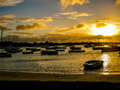 Grand baie mauritius spectacular sunset over the ocean with boats in the calm waters of the indian ocean africa Stock Images