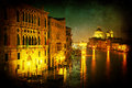 The grand canal in venice at night textured with a vignetted and decorative grunge texture Royalty Free Stock Images