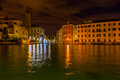 Grand canal in venice at night time view of the with one of the many churches on the left and private apartments and hotel rooms Stock Photography