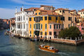 Grand canal venice palazia and a water taxi on the in italy Stock Images
