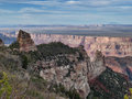 Grand canyon from the north rim with view of flat plateau and mountain in the distance Stock Photo