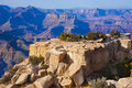 Grand canyon vista rugged blocks of sandstone with pinyon pine trees in front of a of towering buttes and spires at world famous Stock Photos