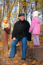 Grand-dad with grandsons in forest in autumn Royalty Free Stock Image