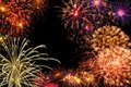 Grand fireworks display fantastic multi colored on black night sky Stock Photography