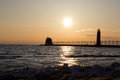 Grand haven lightouse at sunset in the early spring Stock Photos