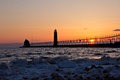 Grand haven lightouse at sunset in the early spring Royalty Free Stock Photo