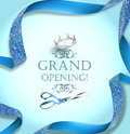 Grand opening invitation card with scissors and blue curly ribbon.